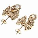 Christian Dior(クリスチャンディオール) ラインストーンリボンピアス(ゴールド) D62775