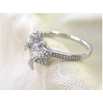 2010年12月21日17時までご注文いただくと、12月25日にお届け可能!K10WG(10金ホワイトゴールド) 0.08ctダイヤモンド入り リボンリースリング12号