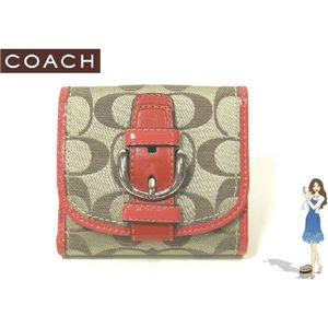 COACH(コーチ) ソーホー シグネチャー フレンチ 2つ折り財布 ピンク 42057